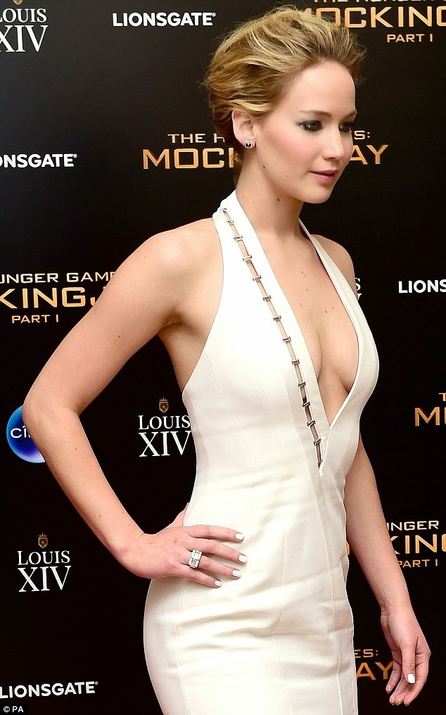Jennifer Lawrence shows off cleavage in a Mugler dress at The Hunger Games: Mockingjay Part 1 London Premiere After Party