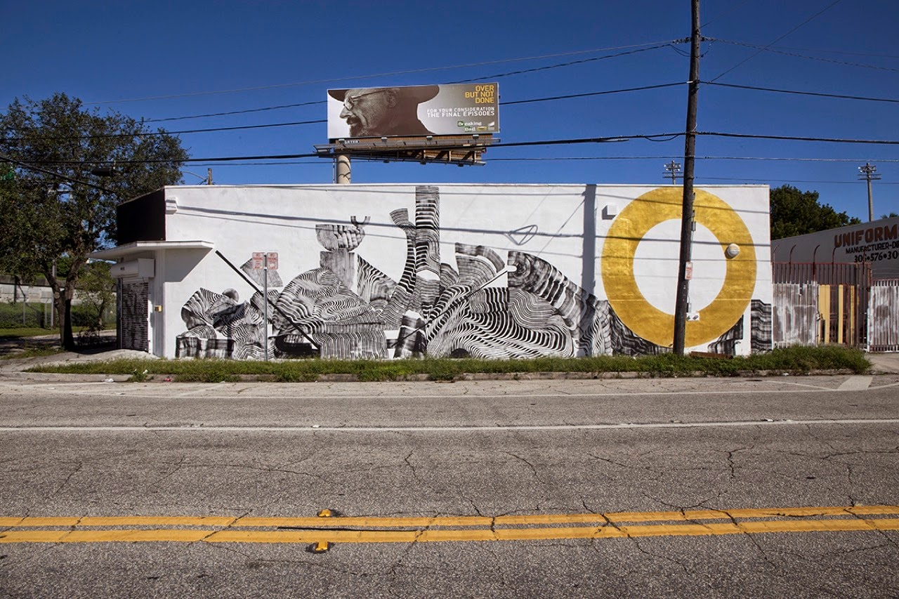 Our friend 2501 has landed in Florida for the upcoming Art Basel 2014 event where he just wrapped up a new piece on the streets of sunny Miami.