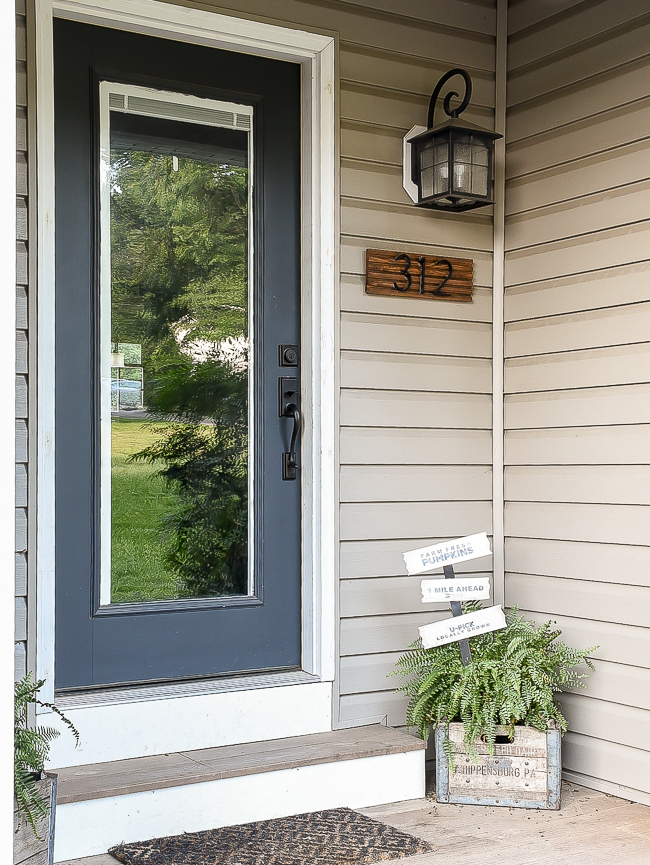 Front Porch with updated Dollar Tree yard sign
