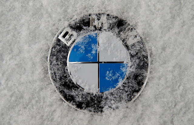 Image Attribute: A frost covered logo of German luxury carmaker BMW is seen in Munich, Germany January 16, 2017. REUTERS/Michael Dalder