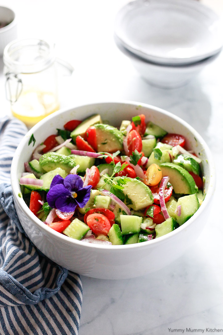 Avocado, tomato, and cucumber salad is hearty and delicious, and naturally vegan and gluten-free.