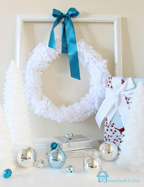 ease and economical wreath made out of felt material in blue and white Christmas vignette