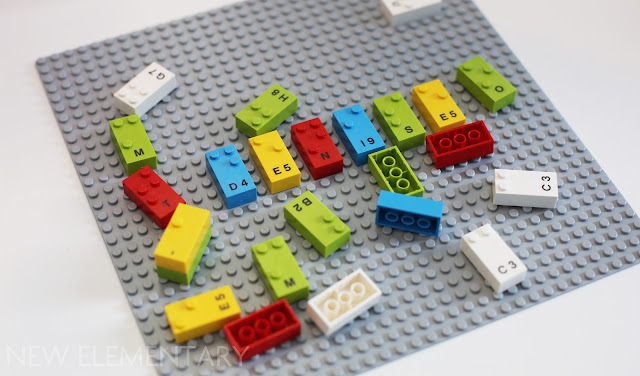 A LEGO base plate showing LEGO Braille Bricks in 5 colours