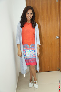 Actress Anasuya Bharadwaj in Orange Short Dress Glam Pics at Winner Movie Press Meet February 2017 (42).JPG