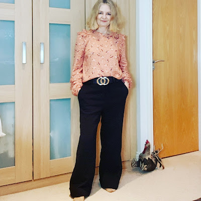 image showing flowery blouse and black wide legged pants