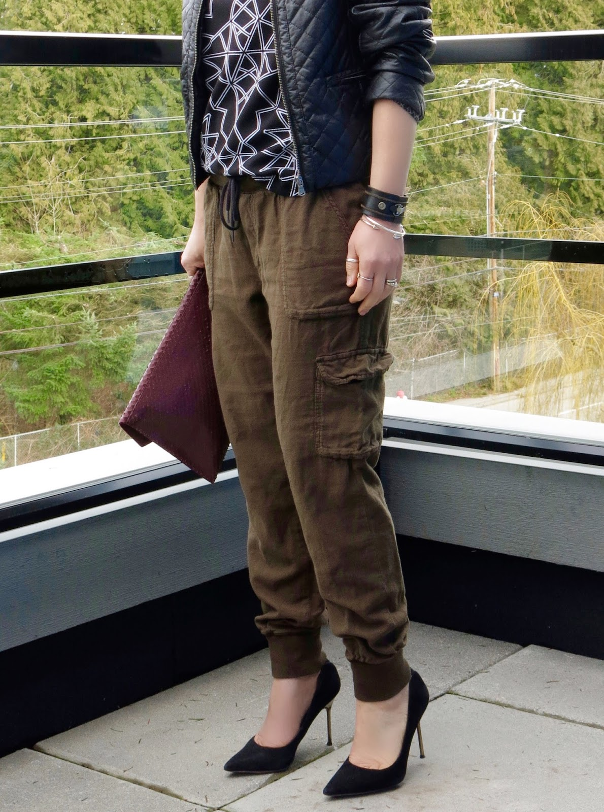 slouchy cargo pants, patterned tee, quilted pleather jacket, and Sam Edelman pumps