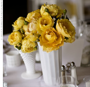 milk glass vase with yellow roses