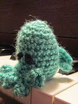 http://www.ravelry.com/patterns/library/chthulu-finger-puppet