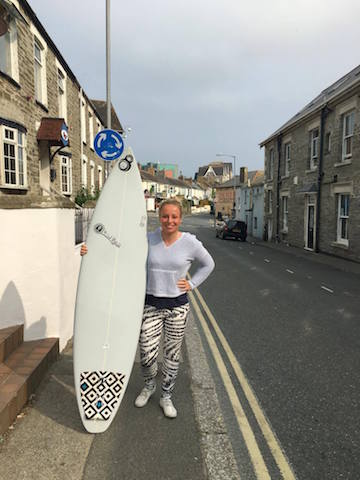 Female surfer holding a shortboard
