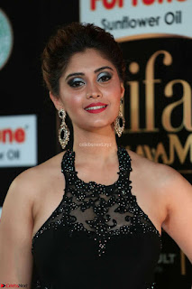 Surabhi in Glittering Sleeveless Leg Split Floor Length Black Gown at IIFA Utsavam Awards March 2017 Exclusive