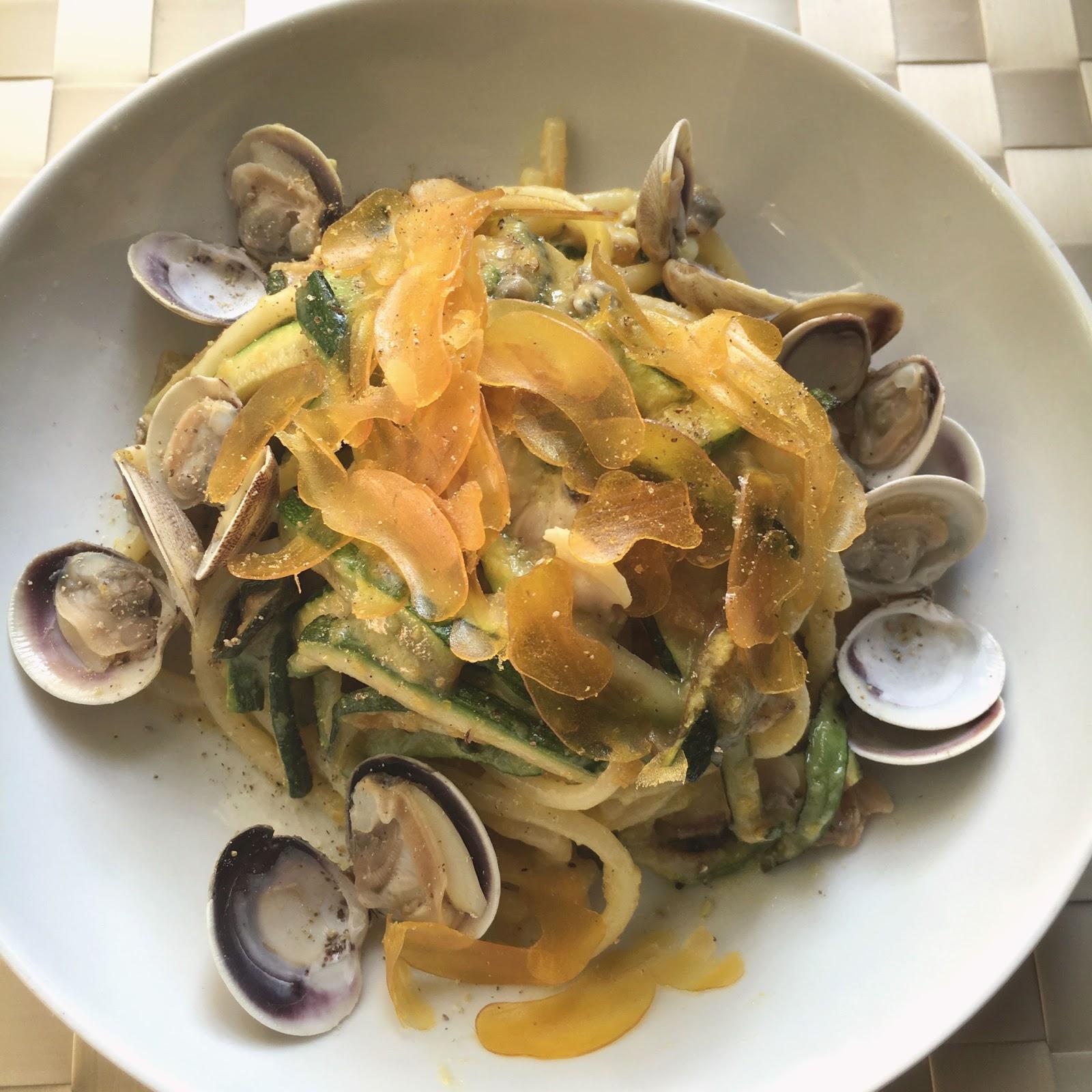 Lemon flavored spaghetti with clams, zucchini and bottarga
