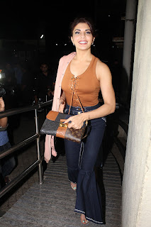 Jacqueline Fernandez looks extremely Cute in Denim Trousers and Sleeveless Orange Top