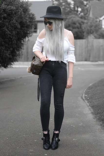 Sammi Jackson - Primark Black Fedora / Zaful Sunglasses / Boohoo Off Shoulder Top / Louis Vuitton Palm Springs Mini Backpack / Primark Ripped Jeans / MIssguided Buckled Ankle Boots