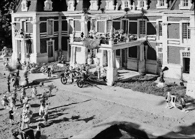 b/w image of Versailles model showing weathering and deterioration