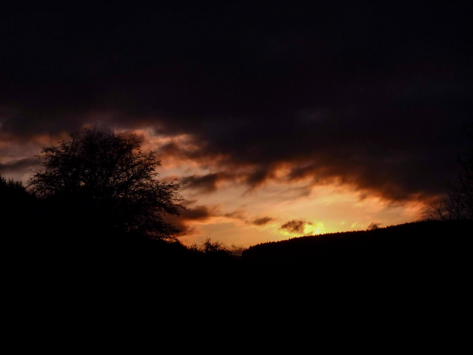 A dark mountainside sunset in North Cork.