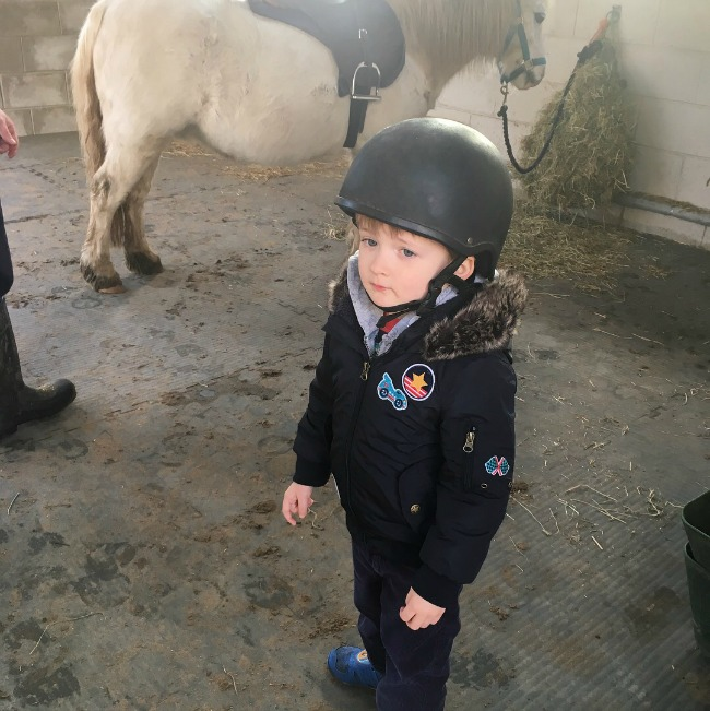 boy-wearing-riding-helmet-at-Cefn-Mably-Farm-Park
