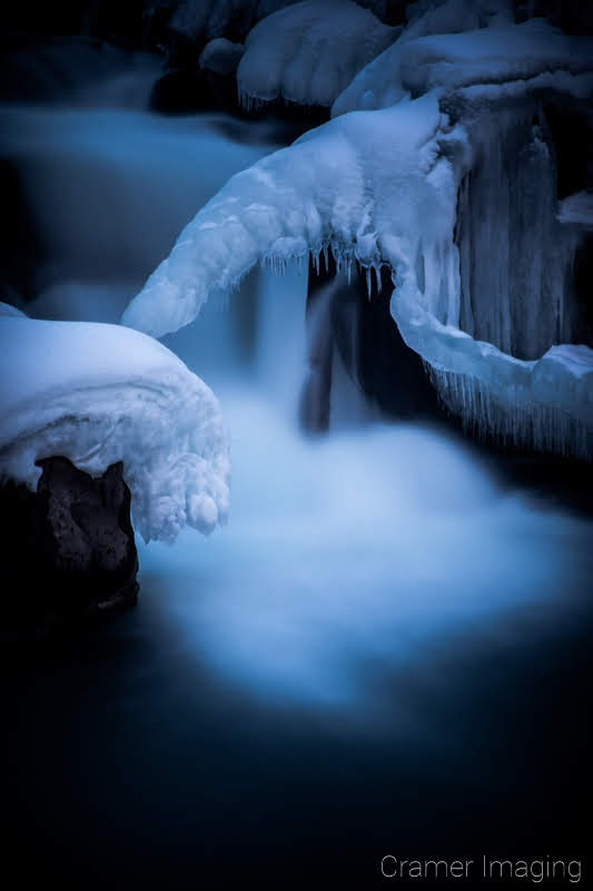 Cramer Imaging's nature photograph of a silky waterfall in the snow during winter in Idaho Falls, Idaho