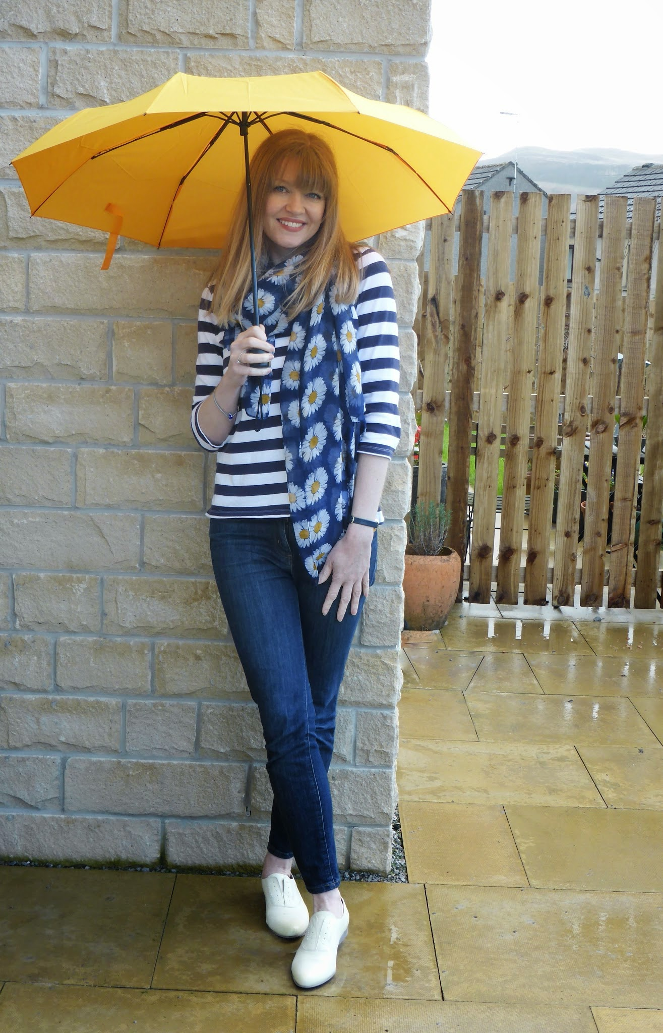 What Lizzy Loves, over 40 fashion blogger wears navy and whiteJack Wills breton striped top, skinny jeans, blue daisy scarf, yellow brogues and yellow umbrella