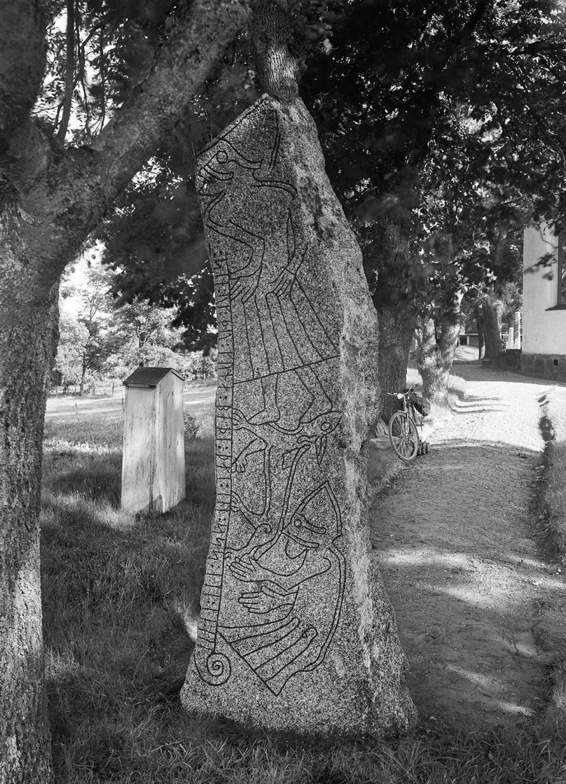 A runestone in Ledberg, Östergötland. The stone has mythological images, possibly from the Ragnarök myth, with the Fenris wolf devouring Odin. The inscription, on three sides, says,
