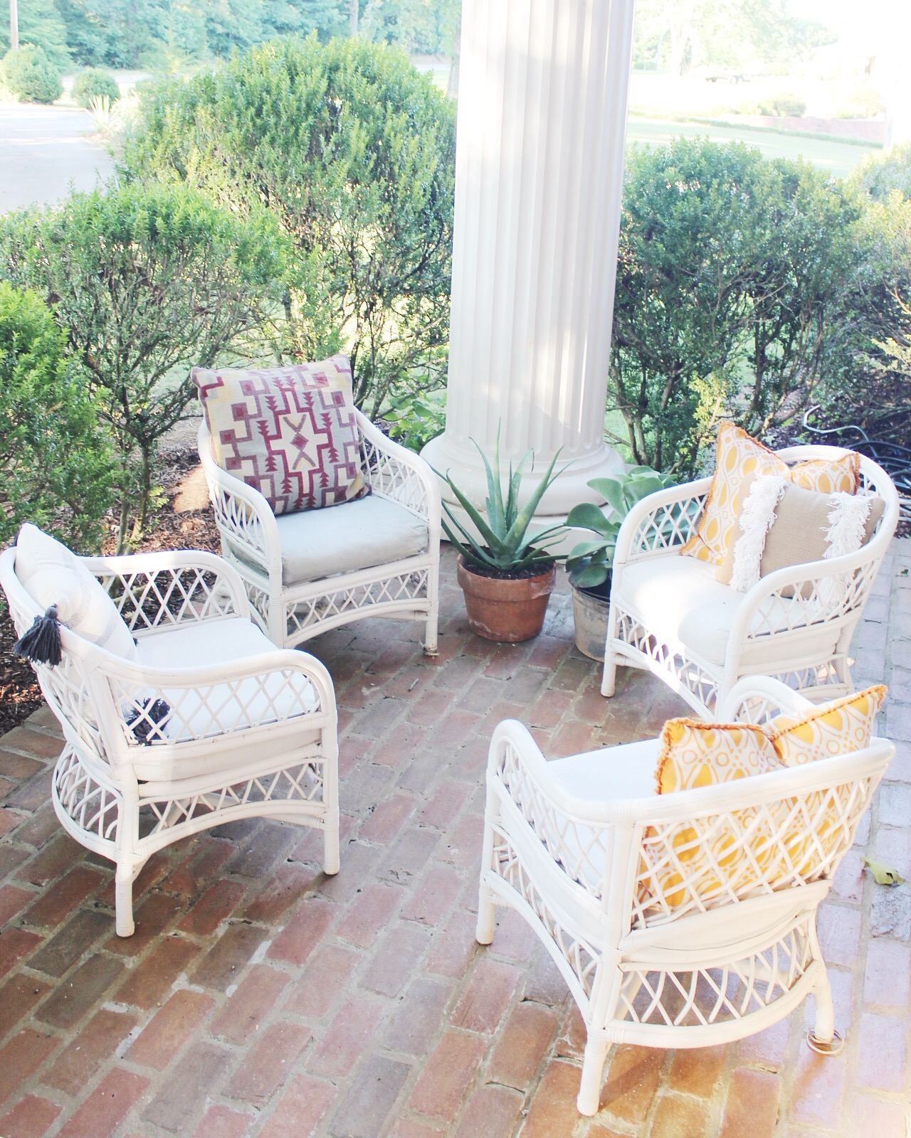 Four wicker chairs with cushions 60