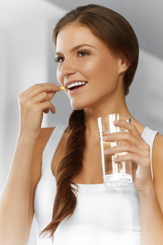 Woman Taking Supplements