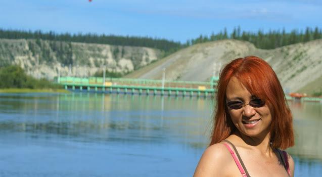 Lady at the start of Yukon River in Yukon Territory