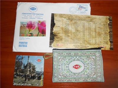 الحصول على حقيبة يد من تركيا و بطاقة بريدية مجانا من راديو تركيا  الى باب منزلك