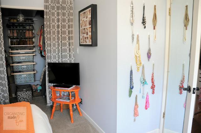 Necklaces organized behind bedroom door