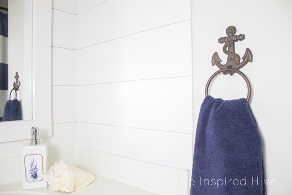 Nautical hand towel holder and accessories.