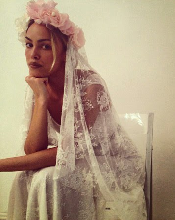 Bride wearing a Traditional Lace Veil with Flowers