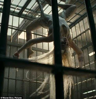 Harley Quinn Swinging In Jail Cell