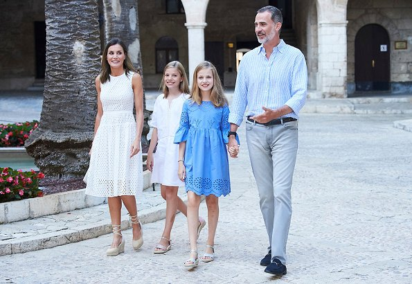 Queen Letizia wore a new white cotton dress from Dafalia collection of Hugo Boss. Princess Leonor and Infanta Sofia on holiday