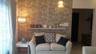 Wallpapered wall with Couch & Lighting