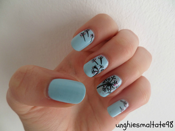 Idea about dandelion nail art 2016 fashion newbys then this light blue matte base color will surely catch your attention added with black nail polish for painting the dandelion silhouettes with tiny prinsesfo Gallery