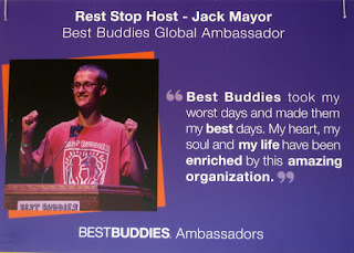 Sign featuring Rest Stop Host - Jack Mayor, Best Buddies Global Ambassador. Quote: Best Buddies took my worst days and made them my best days. My heart, my soul and my life have been enriched by this amazing organization.