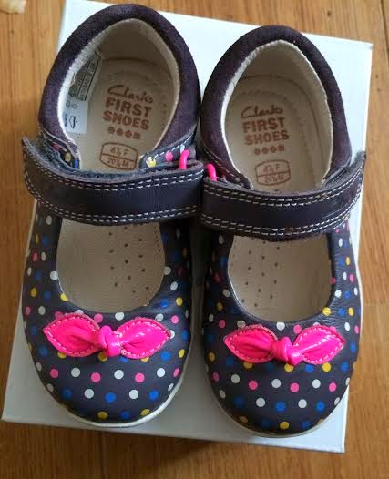 First paid of clarks shoes, navy blue with colourful dots on and a pink bow