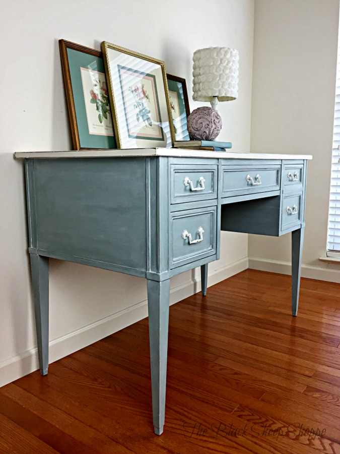 Side view of desk painted in duck egg blue.