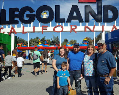 The front gate at Legoland California with Benjamin, Elisa, Tim, Cindy and Jimmy posing for a picture.