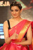 Kajal Aggarwal in Red Saree Sleeveless Black Blouse Choli at Santosham awards 2017 curtain raiser press meet 02.08.2017 052.JPG