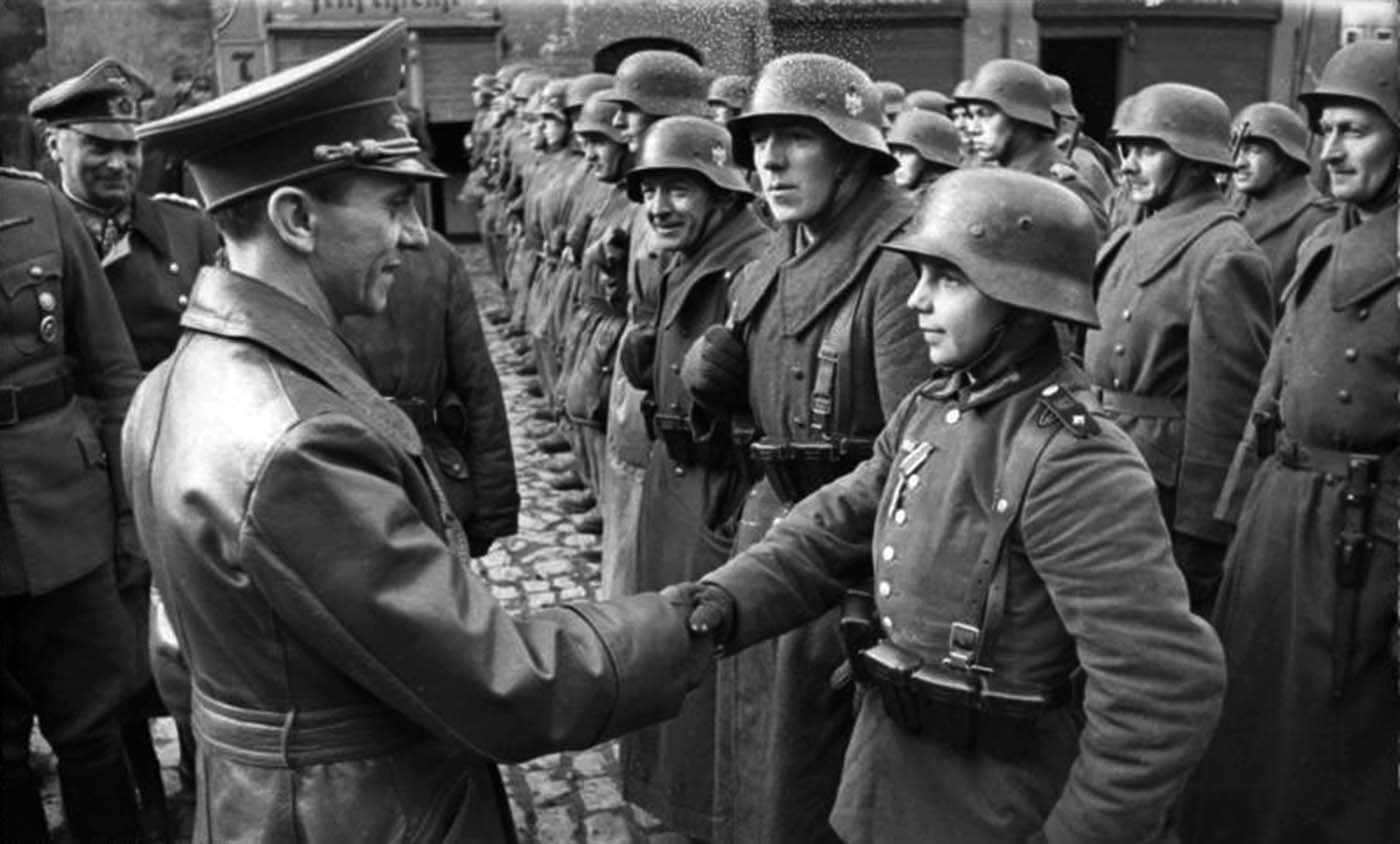 Dr. Goebbels, Reichsminister für Volksaufklärung und Propaganda (Reich Minister of Public Enlightenment and Propaganda) visited Lauban shortly after the liberation with the camera crews of the Wochenschau. Here he is seen congruatulating the 16-years-old Willi Hübner.