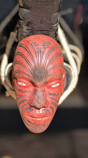 Carved wooden face on the front of a Maori canoe at the Waitangi Treaty Grounds