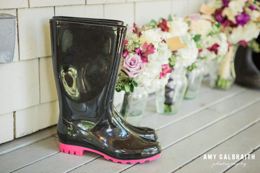 pink and black rain boots with wedding bouquets