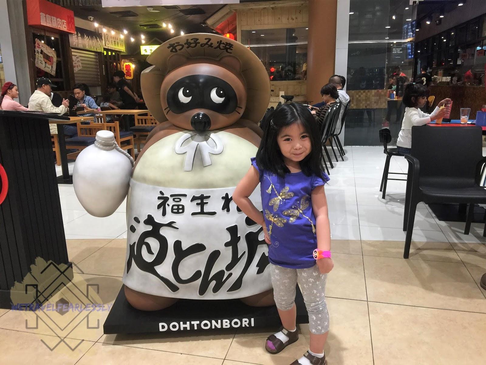 Raccoon Dog - Dohtonbori's brand mascot w/ Chloe of WeTravelFearlessly