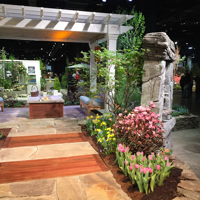 I love the way they combined wood planks and stone together in this beautiful garden walkway | Boston Flower & Garden Show 2017