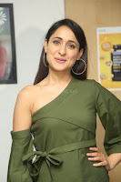 Pragya Jaiswal in a single Sleeves Off Shoulder Green Top Black Leggings promoting JJN Movie at Radio City 10.08.2017 094.JPG