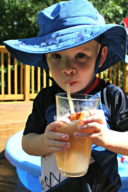 Kid drinking peach fizz