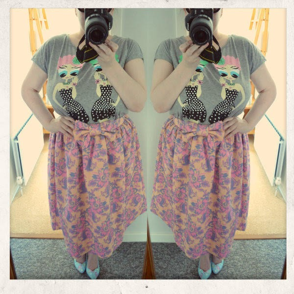 Plus size blogger wearing floral skirt, girl print t-shirt and mermaid print shoes