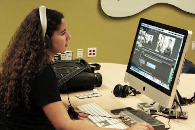 SPOT 127 student editing in an audio studio