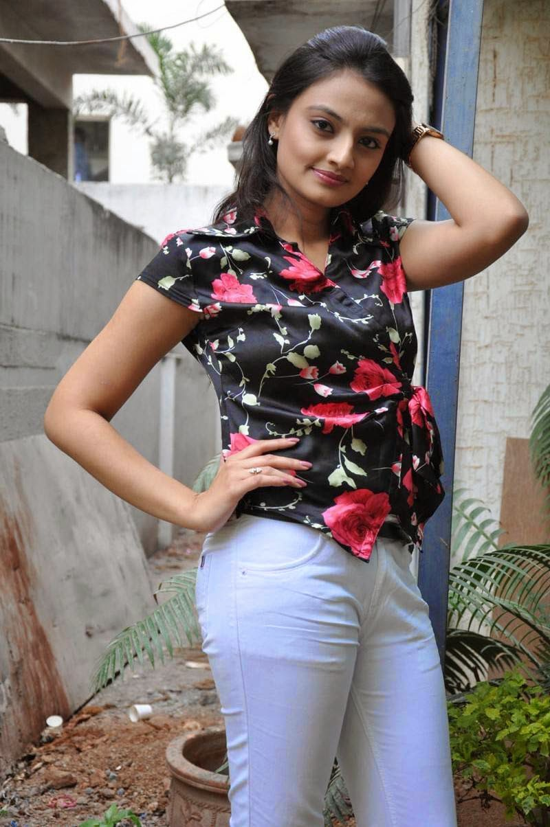 Nikitha Narayan Photoshoot In Black Top White Jeans At Movie Press Meet