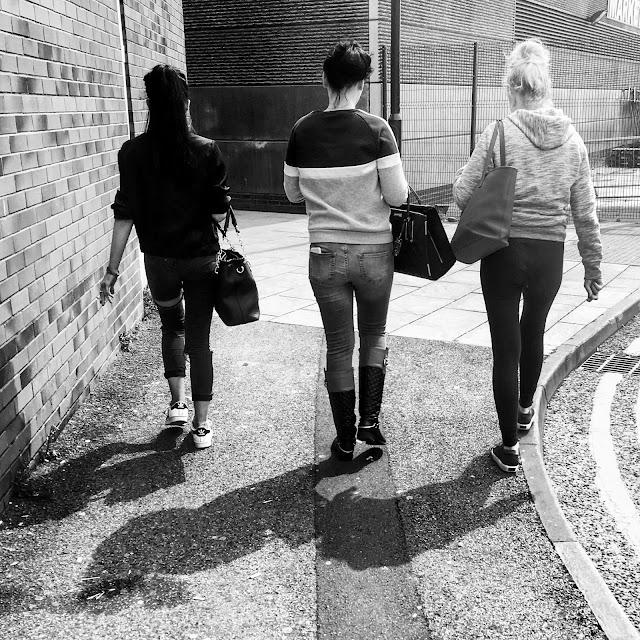 three girls walking, back of the head shot